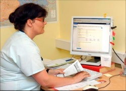 A project team member enters anonymised patient data from the questionnaire on...