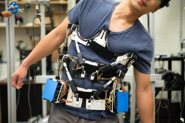Prototype wearable spine brace: sensors record the force and motion data and...