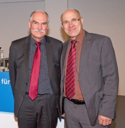 Professors Volker Bühren (left) and Wolfram Mittelmeier at the symposium.
