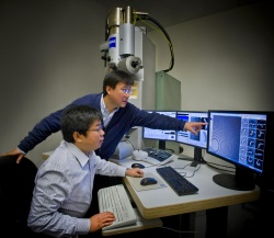 Gang Ren (standing) and Lei Zhang participated in a study at Berkeley Labs...