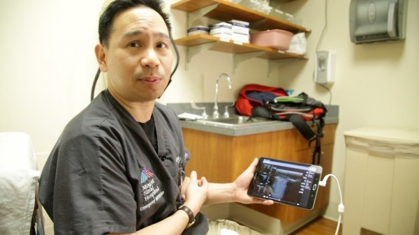 Dr. James Tsung, MD, showcases a lung ultrasound display on a tablet.