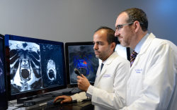 Dr. Daniel Costa, left, and Dr. Ivan Pedrosa, right, review multiparametric MRI...