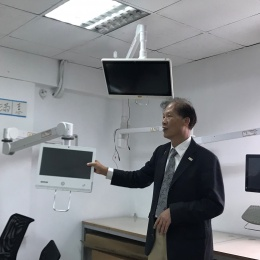 man presenting medical monitors