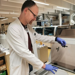 Martin Christman fills sample tubes into a bulk loader, which automatically...