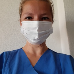 A song in her heart, a mask on her face: Dr. Susann Kobus, music therapist at...