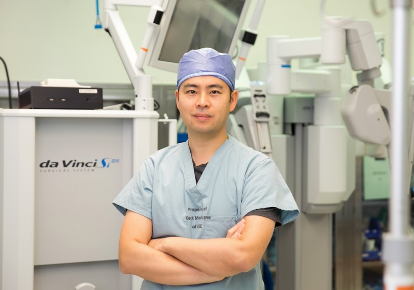 Andrew Hung, MD, with the black box recorder and da Vinci Surgical System.