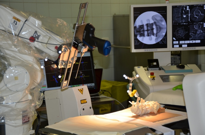 An assistance system for minimally invasive spinal surgery: Robot-assisted...