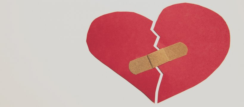 cutout paper heart fixed with band-aid
