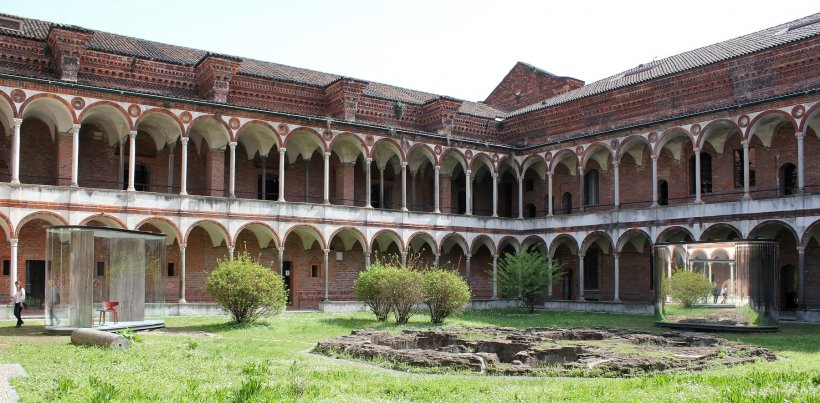mirrored cells in a 15th century hospital courtyard in milano
