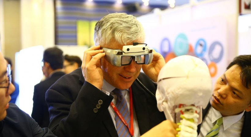 man using augmented reality glasses at a medical fair