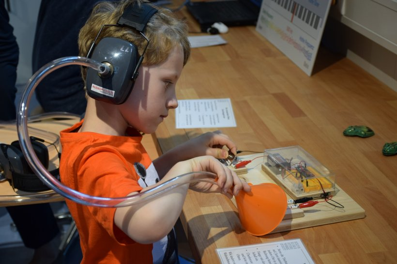 boy with headphones in a sound museum
