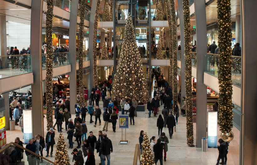 people in a shopping centre with christmas decoration