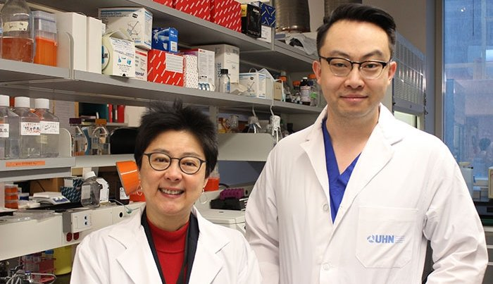 Dr. Fei-Fei Liu and Dr. Xiao Zhao standing in a laboratory
