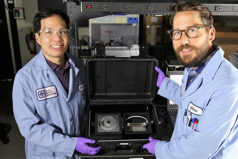 Sandia National Laboratories chemist Chung-Yan Koh, left, and former Sandia...