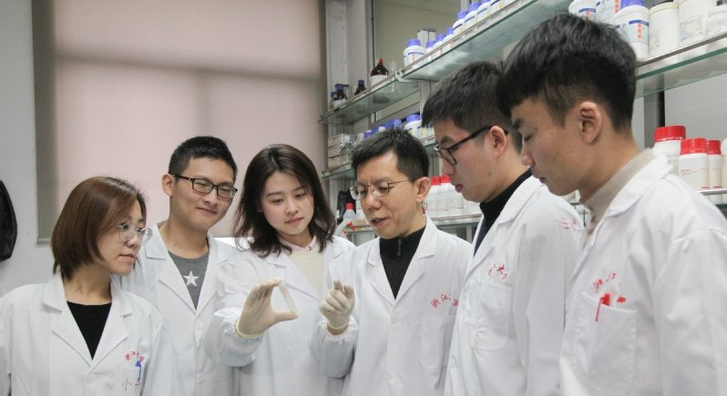 chinese scientists in a laboratory environment