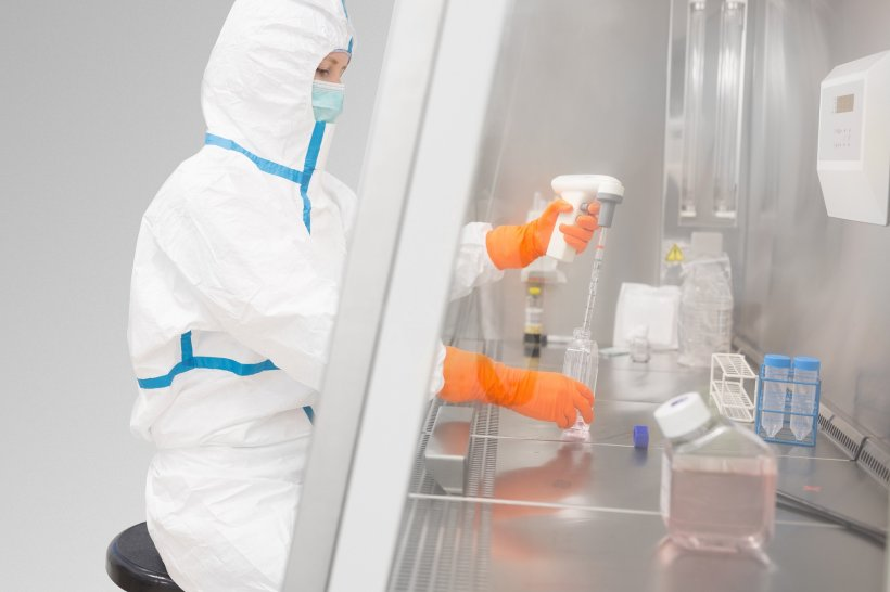 female laboratory worker in safety suit