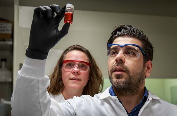 Drs. Jen Adair (left) and Reza Shahbazi examine a test batch of gold...