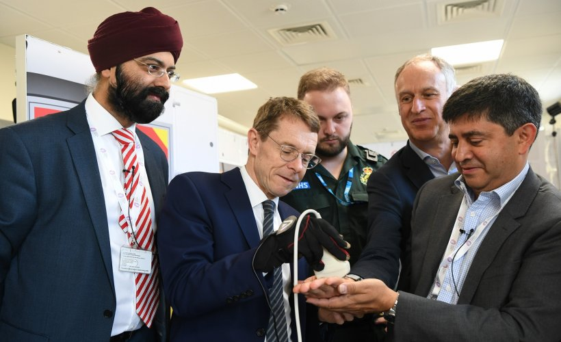Andy Street, Mayor of the West Midlands, tries out the haptic glove alongside...
