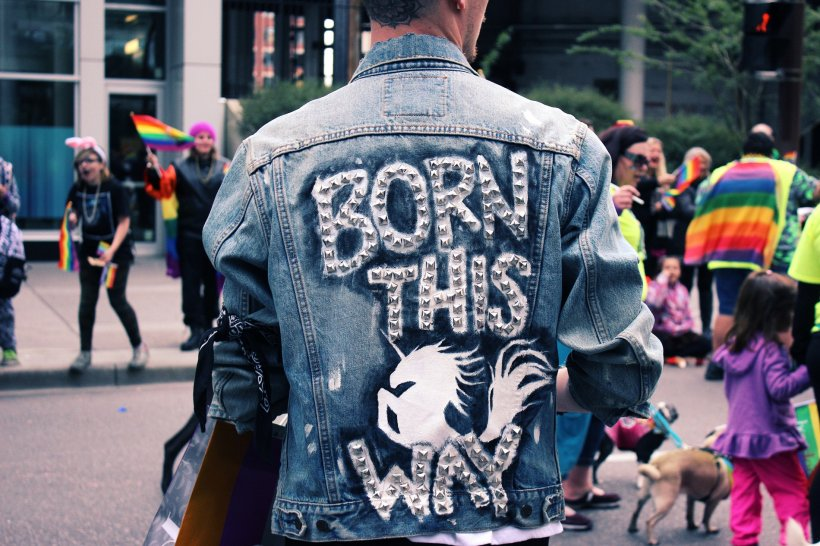 person wearing denim jacket at gay pride festival