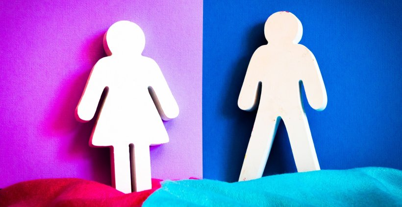white woman and man silhouette cutouts in front of pink and blue background