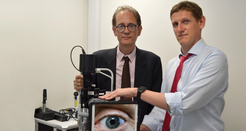 Dr Mario Giardini & Dr Iain Livingstone with a slit lamp used in virtual...