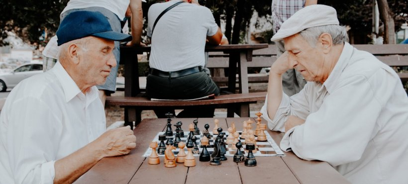 two senior men playing chess