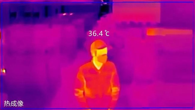 thermal image of a man wearing a cap and protective mask