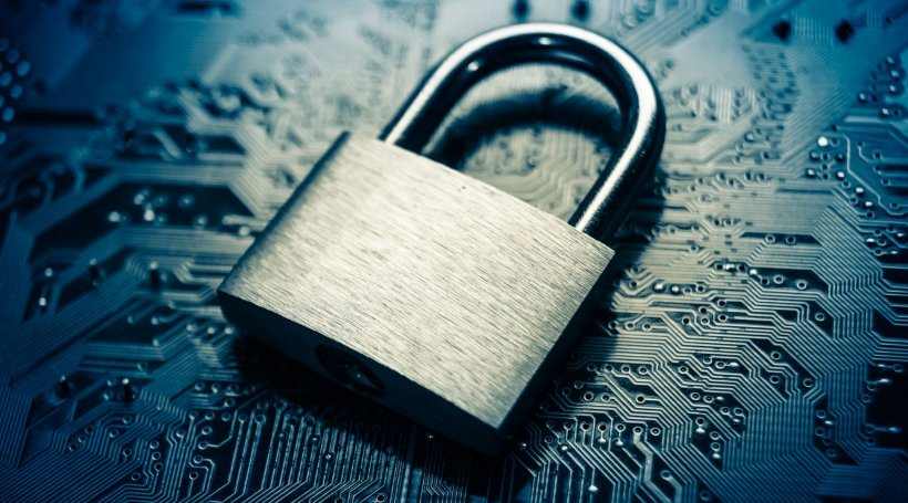 cybersecurity concept; metal padlock on digital circuitboard