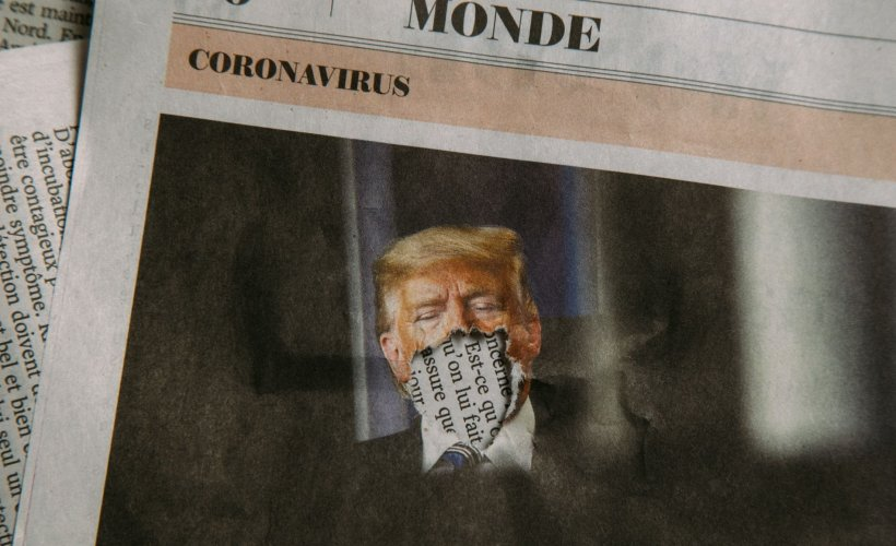 cutout from french newspaper showing donald trump