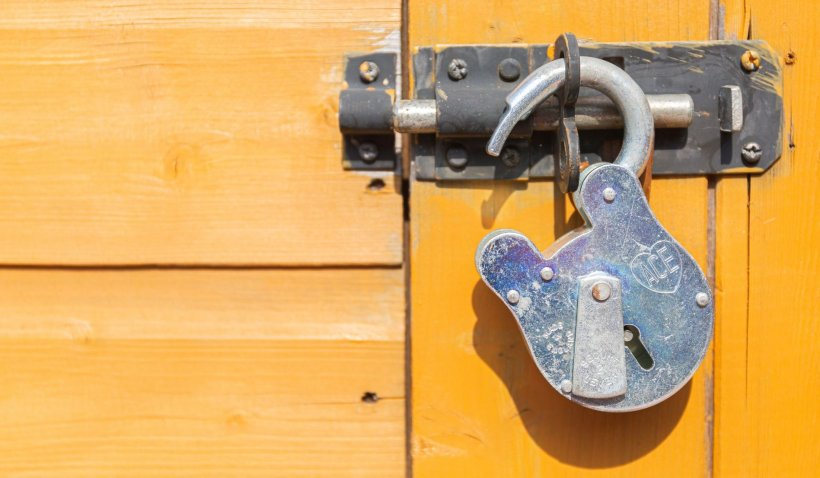 open padlock on wooden door