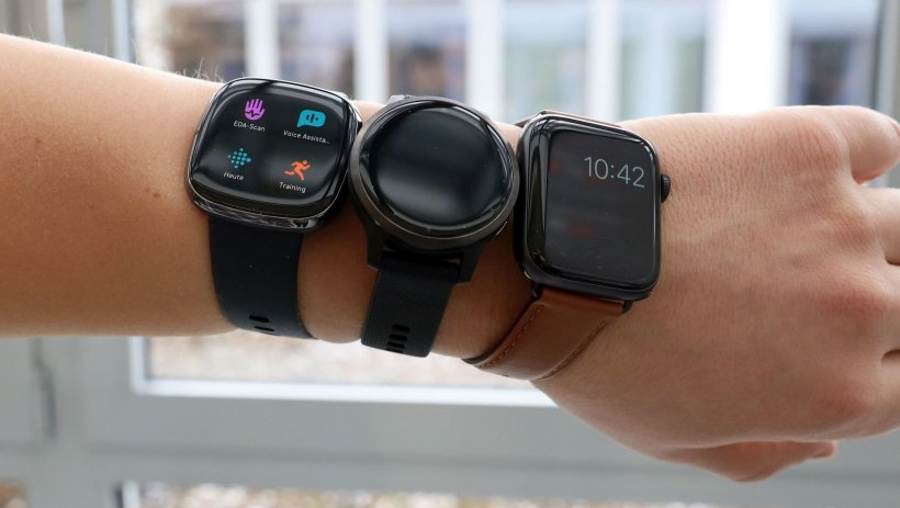 arm with 3 smartwatches