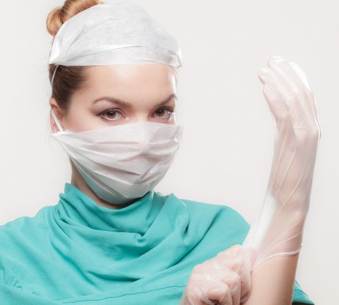 female surgeon wearing mask and glove