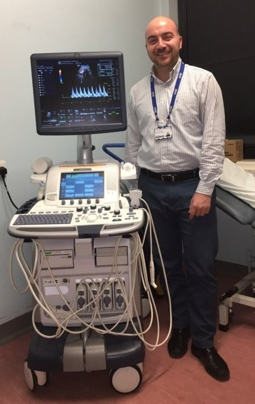 Fabrizio d'Abate standing next to an ultrasound device