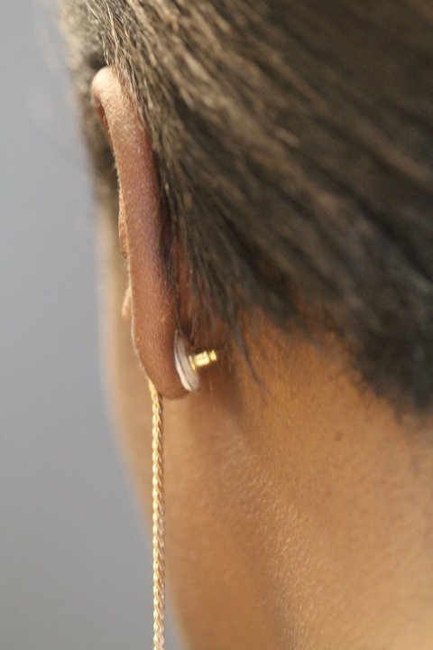 earring seen from the back of a woman's ear