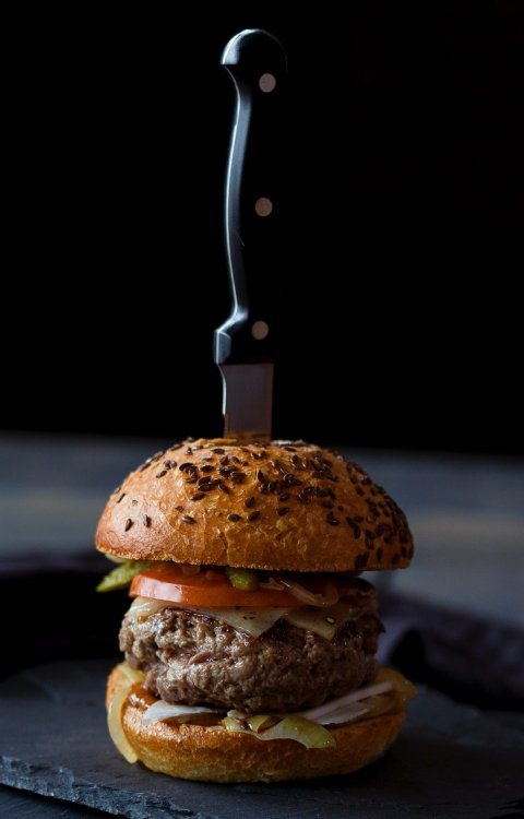 hamburger with knife sticking in the top