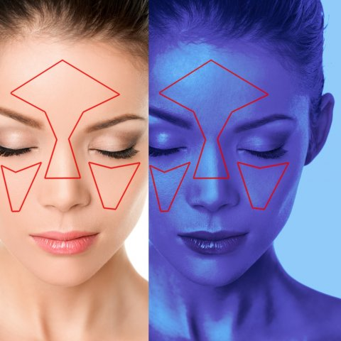 Face skin analysis on woman at beauty clinic with UV blue light