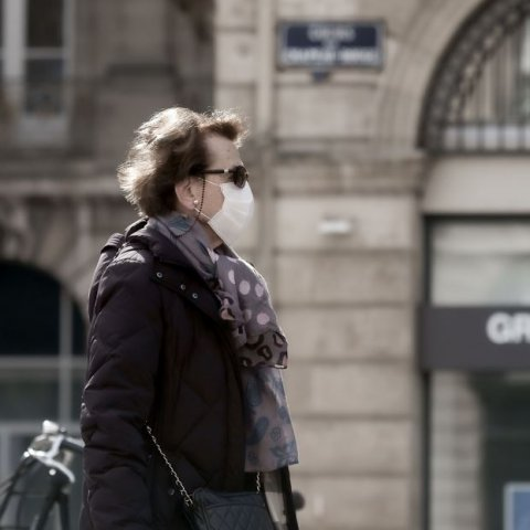 woman wearing protective face mask and sunglasses in france