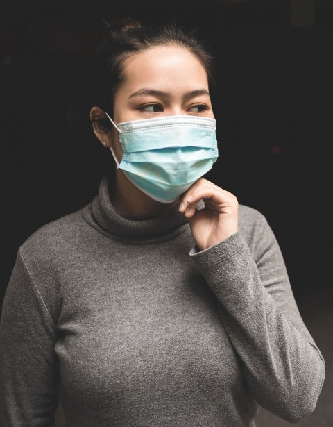 asian woman wearing teal face mask