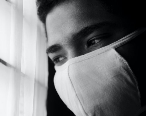 grayscale photo of man wearing face mask