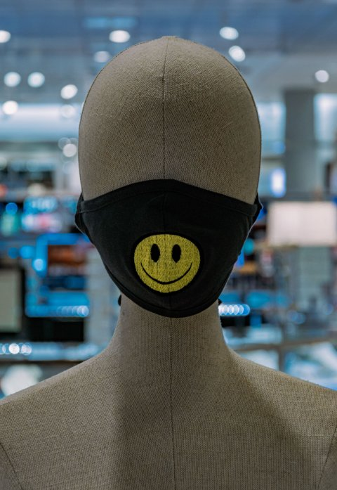 mannequin wearing face mask with smiley