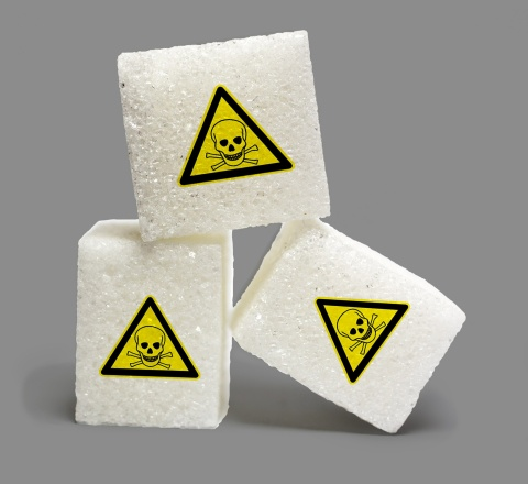 sugar cubes with danger signs