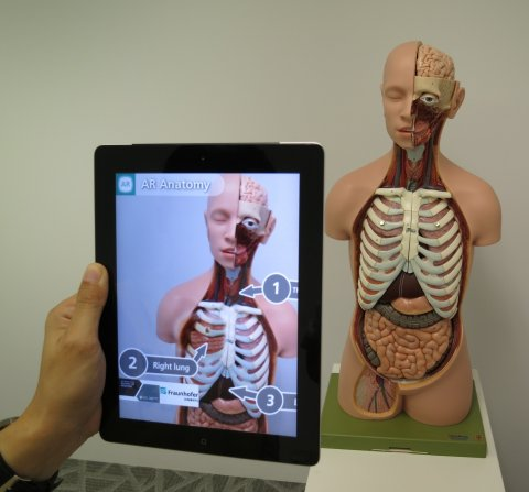 human anatomy model seen though a tablet computer with augmented reality software