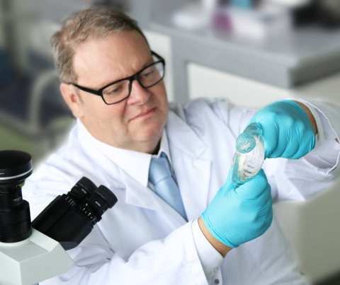 scientist holding faulty breast implant