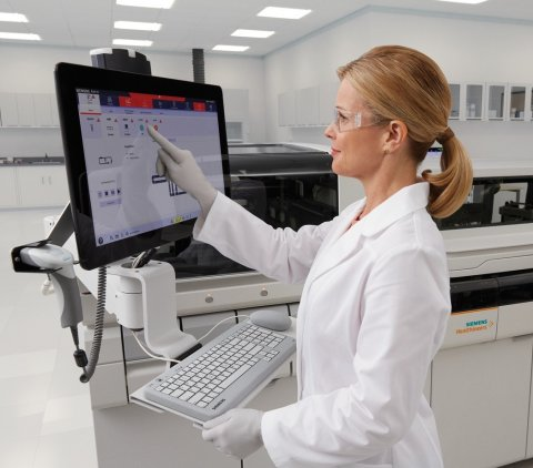 woman in a laboratory operating a touchscreen